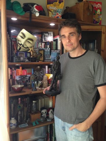 """Festival organizer Aaron Vanek holding his """"Howie"""" lifetime achievement award for contributions to Lovecraft cinema and culture."""