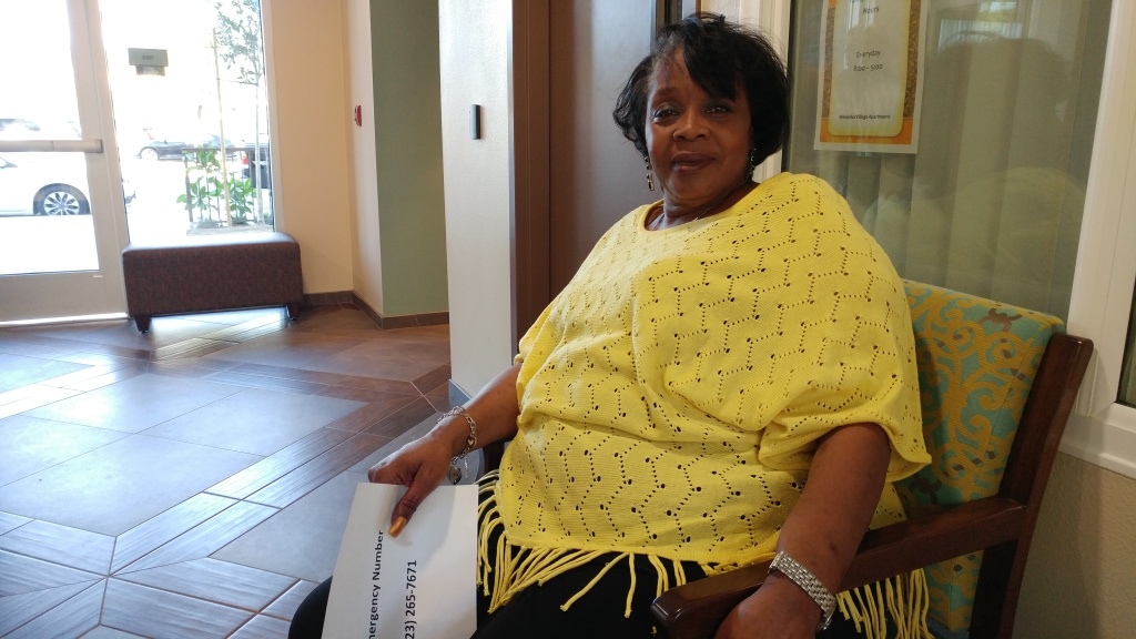 Brenda Hinson, 66, sits in the lobby of her new home: the Winnetka Villa Apartments. On Thursday, the complex's developer, PATH, hosted a grand opening ceremony for the apartments. The building's 94 units will all be filled by formerly homeless senior citizens.