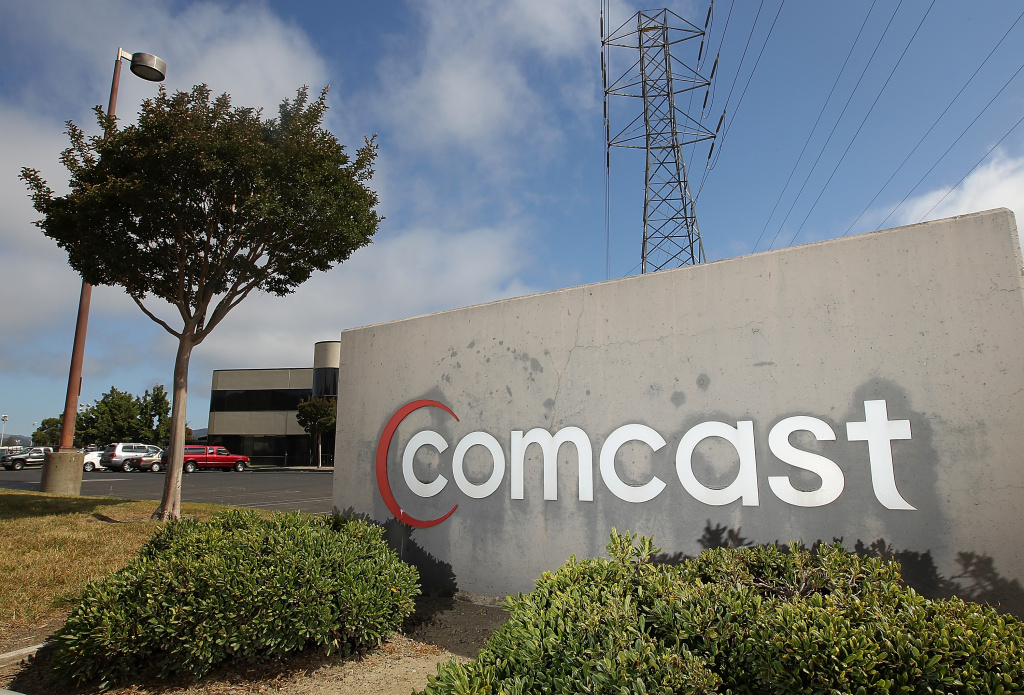 A sign stands in front of a Comcast customer service center on August 3, 2011 in San Rafael, California.