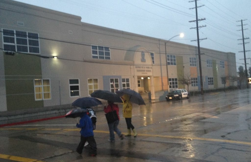 Parents arrive at George De La Torre Jr. Elementary School on January 24, 2013, a day after a 4th grade teacher was arrested on sexual abuse charges.