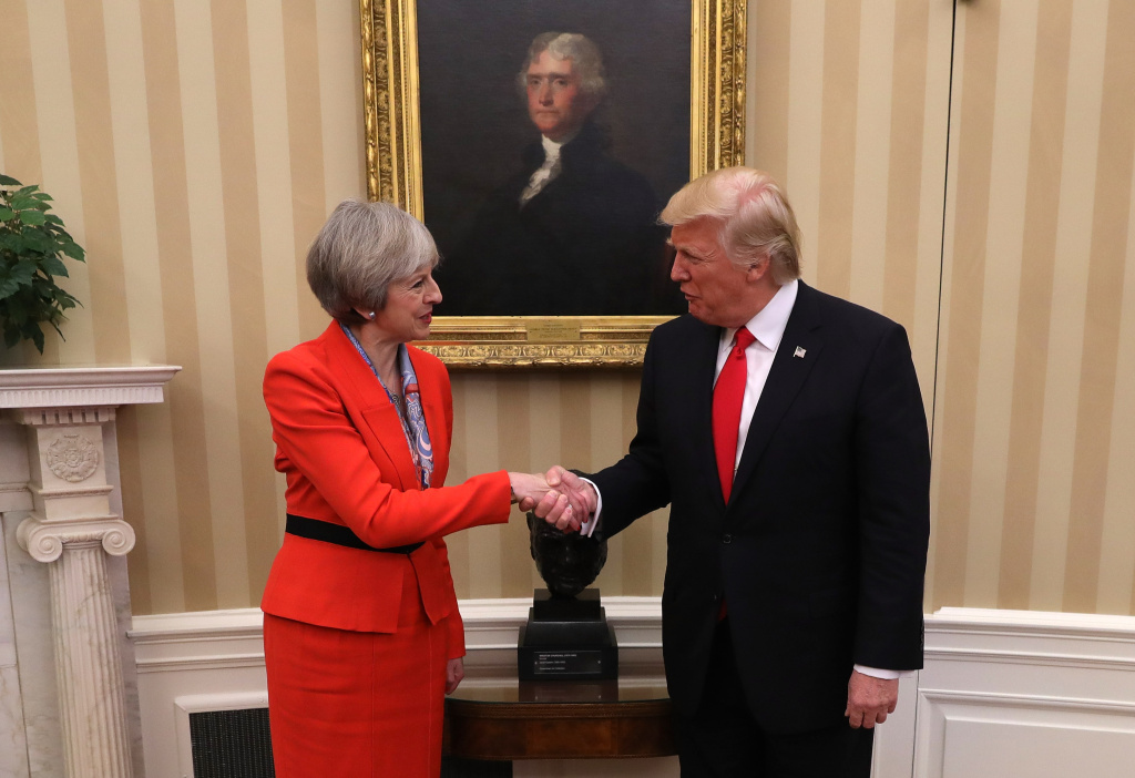British Prime Minister Theresa May shakes hands with U.S. President Donald Trump in The Oval Office at The White House on January 27, 2017 in Washington, DC.