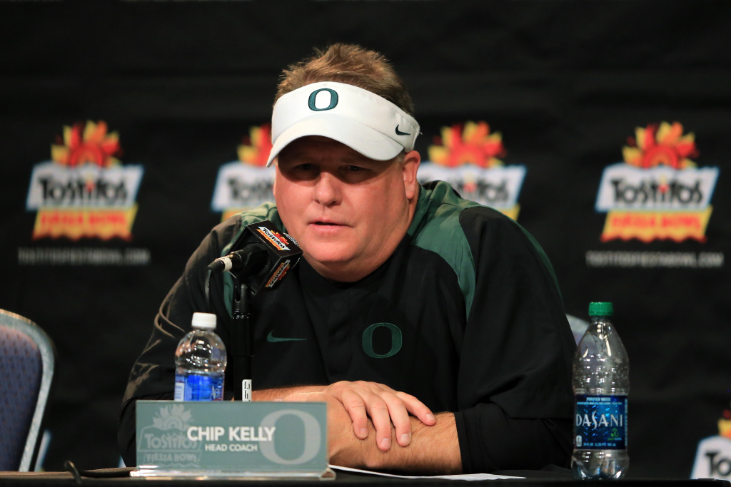 Head coach Chip Kelly of the Oregon Ducks participates in a post-game press conference after they defeated the Kansas State Wildcats the Tostitos Fiesta Bowl on January 3, 2013.