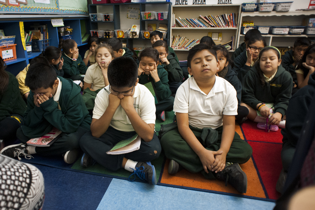 Fourth graders at Camino Nuevo Charter Academy close their eyes and brainstorm theses for an essay assignment.