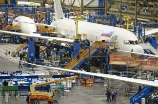 Boeing employees work on a Boeing 787 Dreamliner on one of the assembly lines February 14, 2011 at the company's factory in Everett, Washington. U.S. factory orders increased in December even though companies trimmed their orders for goods that signal investment plans. The Commerce Department says factory orders rose 1.8 percent in December compared to November, when orders had fallen 0.3 percent.