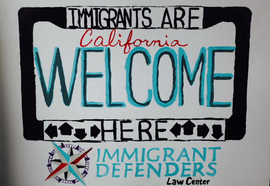 Handmade sign by one of the lawyers at the Immigrant Defenders Law Center