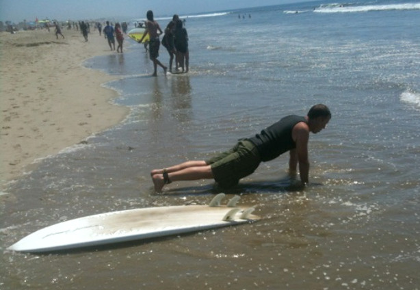 "Santa Monica resident Eric Borkgren, 42, works for a tech services firm that had planned a ""beach day"" to beat the heat, August 24, 2010."