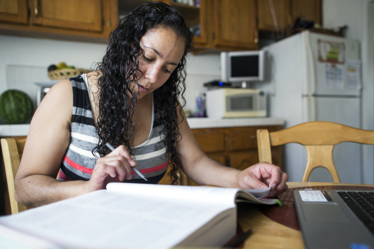 Xochitl Camberos studies every morning in her Inglewood home. Camberos, who received a nursing degree in Mexico, is working to get one in the United States. Camberos is one of many immigrants without legal status in California taking steps to apply for professional licenses under a new state law.
