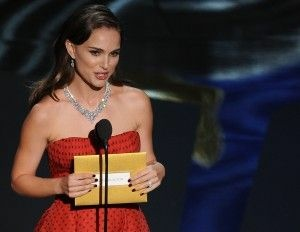 "Natalie Portman presenting the Oscar for Best Actor at the 84th Annual Academy Awards, where she used the term ""undocumented"" in her speech, February 26, 2012"
