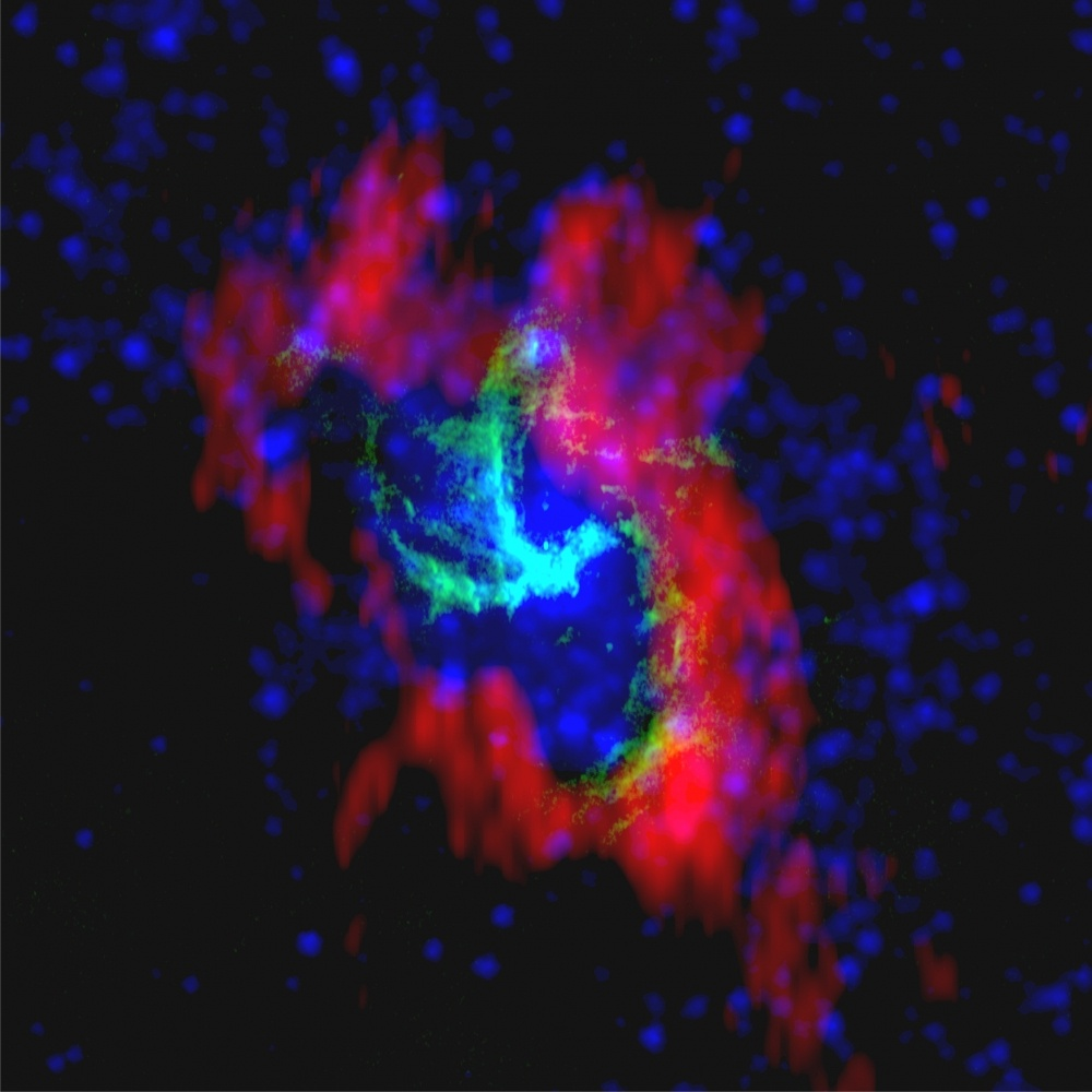 This composite of Sagittarius A-Star combines radio images from the NRAO Very Large Array (green), BIMA (red) and the NASA Spitzer Space Telescope (blue).