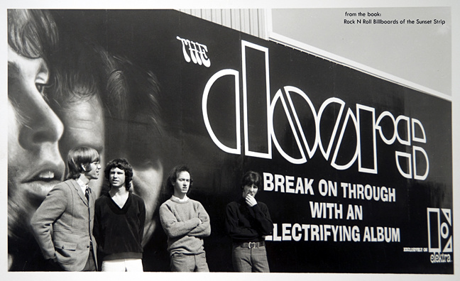 The Doors band members pose their billboard for thier debut record album at Foster and Kleiser studios in Los Angeles.