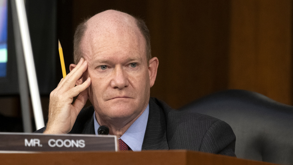 Sen. Chris Coons, D-Del., looks on as Supreme Court nominee Judge Amy Coney Barrett testifies before the Senate Judiciary Committee on the third day of her confirmation hearings.
