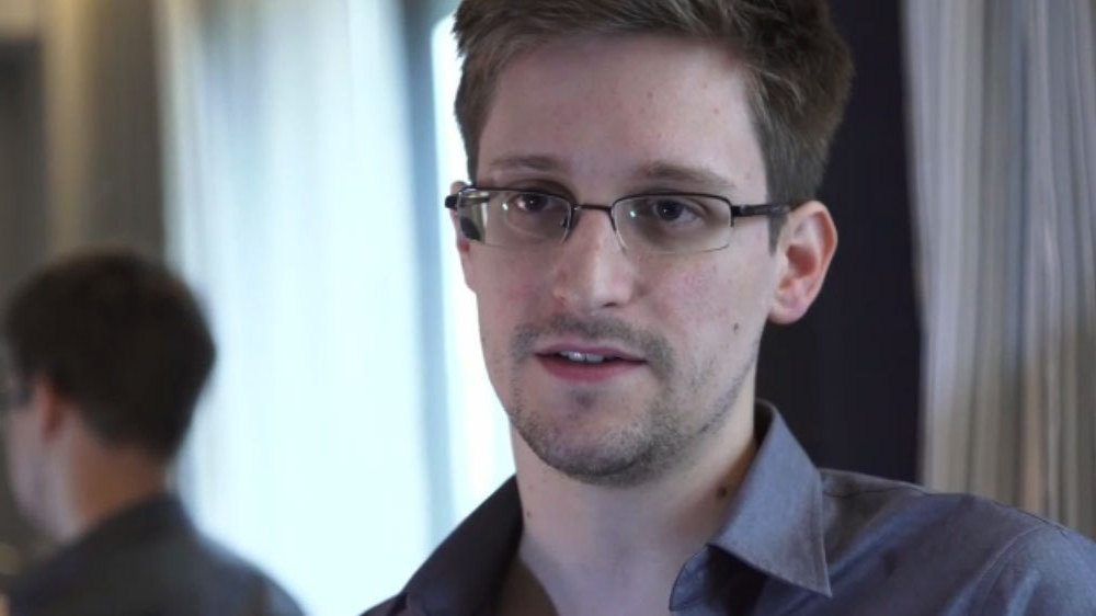 Edward Snowden said Wednesday he's not hiding from justice. Snowden, fired Tuesday by the NSA contractor for whom he worked, Booz Allen Hamilton, talked to The Guardian newspaper about how American surveillance systems work and why he decided to reveal that information to the public.