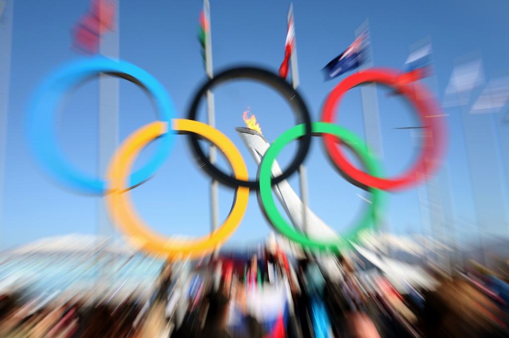 File: A picture taken on February 13, 2014 shows the Olympic Rings and the Olympic flame during the Sochi Winter Olympics in Sochi.