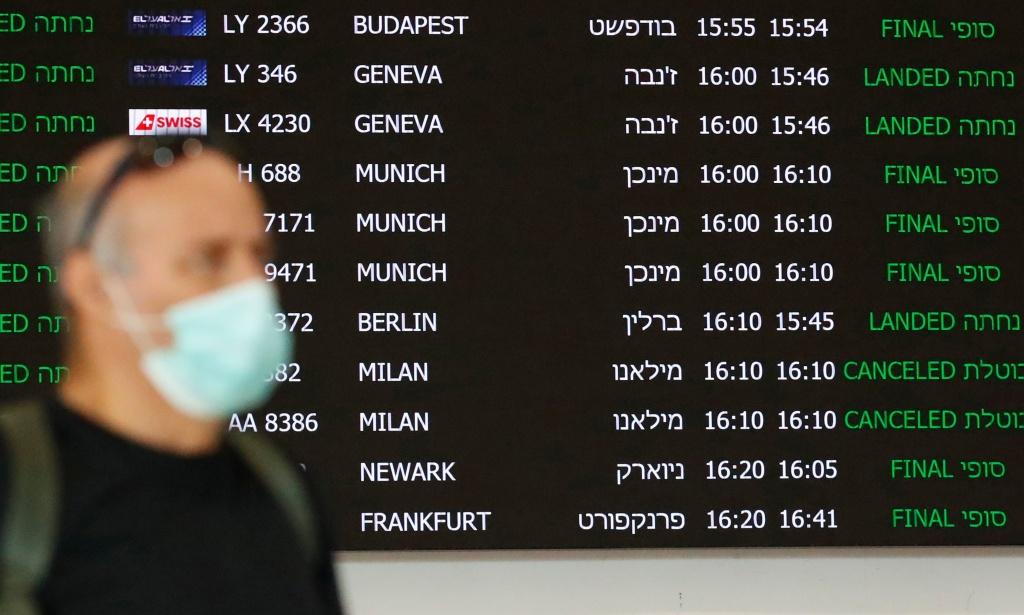 A flight information board displays canceled incoming flights from Italy at Ben Gurion International Airport, near Tel Aviv, Israel, last month. Airlines are slashing hundreds of flights amid fear of the spreading coronavirus.