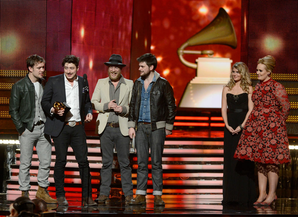 Musicians Ben Lovett, Marcus Mumford, Ted Dwane and Winston Marshall of Mumford & Sons accept Album of the Year award for 'Babel' with presenter Adele onstage at the 55th Annual GRAMMY Awards at Staples Center on February 10, 2013 in Los Angeles, California.