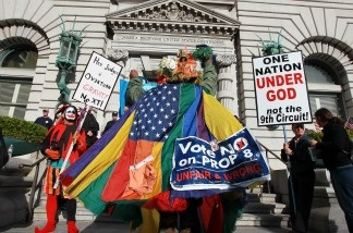 An opponent of Prop 8 wears a gay pride flag as he dances in front of Prop 8 supporters outside of the Ninth Circuit Court of Appeals on Dec. 6, 2010 in San Francisco. A three-judge panel of the 9th U.S. Circuit Court of Appeals in San Francisco heard arguments Monday on the anti-gay marriage proposition after a trial court judge overturned the voter-approved ban ruling it a violation of civil rights.
