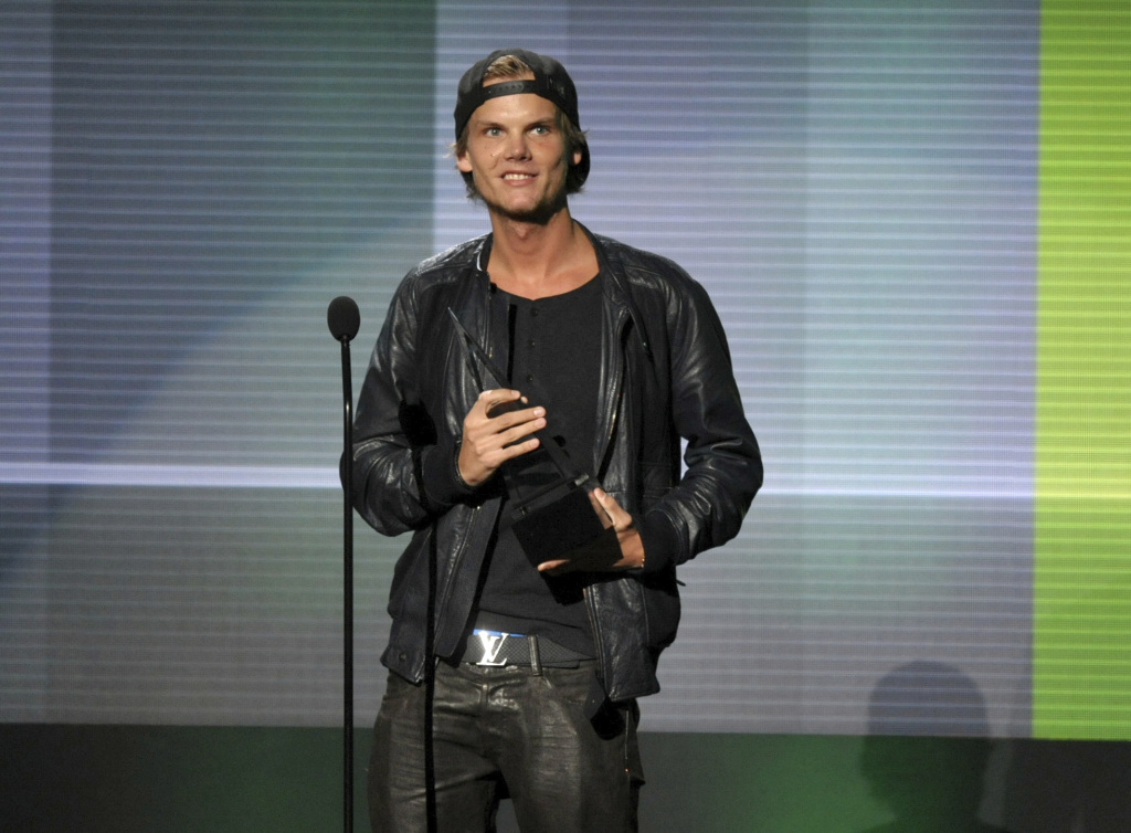 In this Nov. 24, 2013 file photo, Avicii accepts the award for favorite artist - electronic dance music at the American Music Awards in Los Angeles. Swedish-born Avicii, whose name is Tim Bergling, was found dead, Friday April 20, 2018, in Muscat, Oman. He was 28.