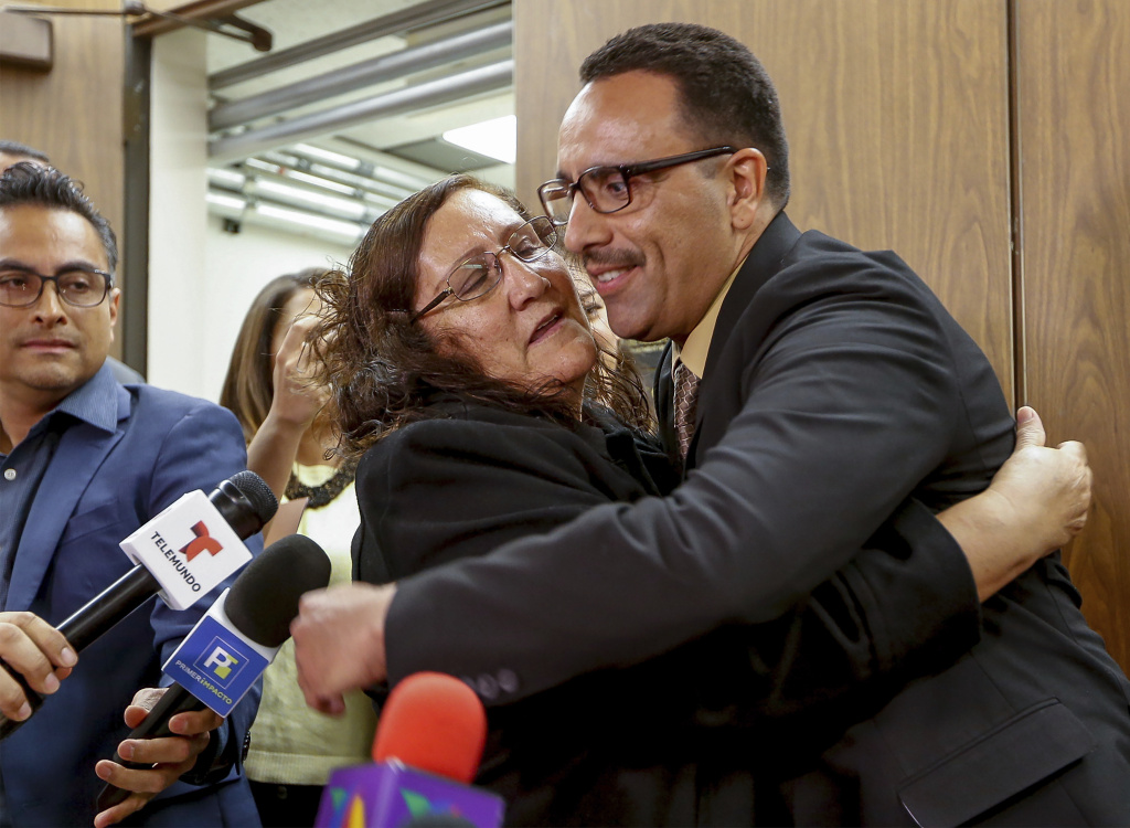 Marco Contreras, 41, is embraced by his mother, Maria Contreras, as his lawyers cheer following a Los Angeles court hearing on March 28, 2017, during which he was declared factually innocent. Contreras, whose attempted-murder conviction was tossed by a California judge, walked free after 20 years in prison.