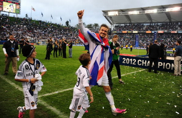 David Beckham salutes the fans as he walks off the pitch after the Los Angeles Galaxy beat Houston Dynamo 3-1 in the Major League Soccer (MLS) Cup, December 1, 2012 in Carson,.California.