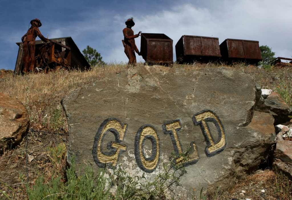 SUTTER CREEK, CA - APRIL 28:  Figures depicting miners stand next to old ore carts outside of the Sutter Gold Mine.