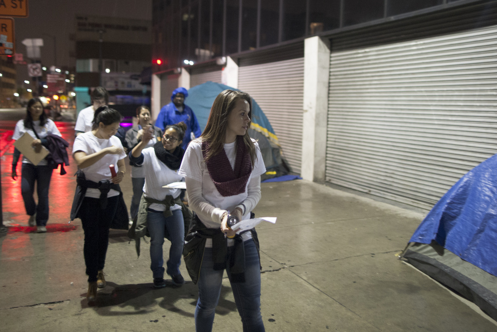 Staci Pedersen (R) and other volunteers count homeless people on Skid Row during the Los Angeles Homeless Count conducted by the Los Angeles Homeless Services Authority (LAHSA) in Los Angeles, California.
