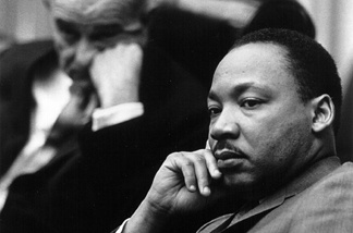 Rev. Martin Luther King Jr. with President Lyndon B. Johnson in the background March 18, 1966 at the White House.