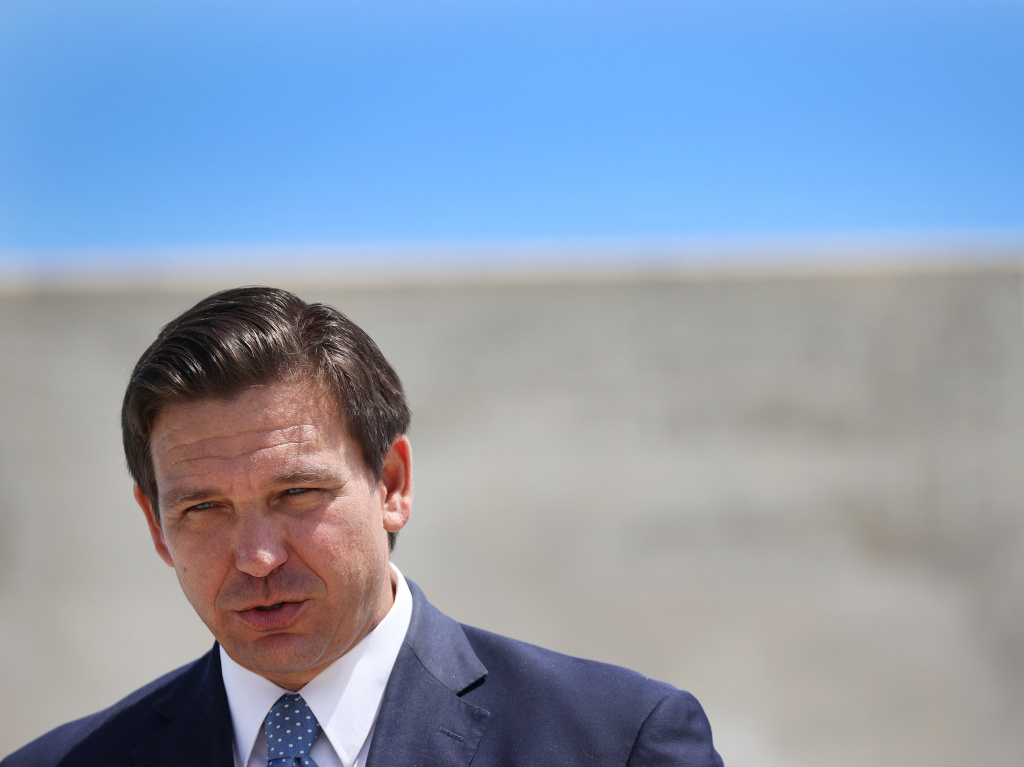 Florida Gov. Ron DeSantis speaks to the media about the cruise industry during a press conference at PortMiami in April. DeSantis faces criticism for failing to do all he could on Florida's biggest environmental threat: climate change.
