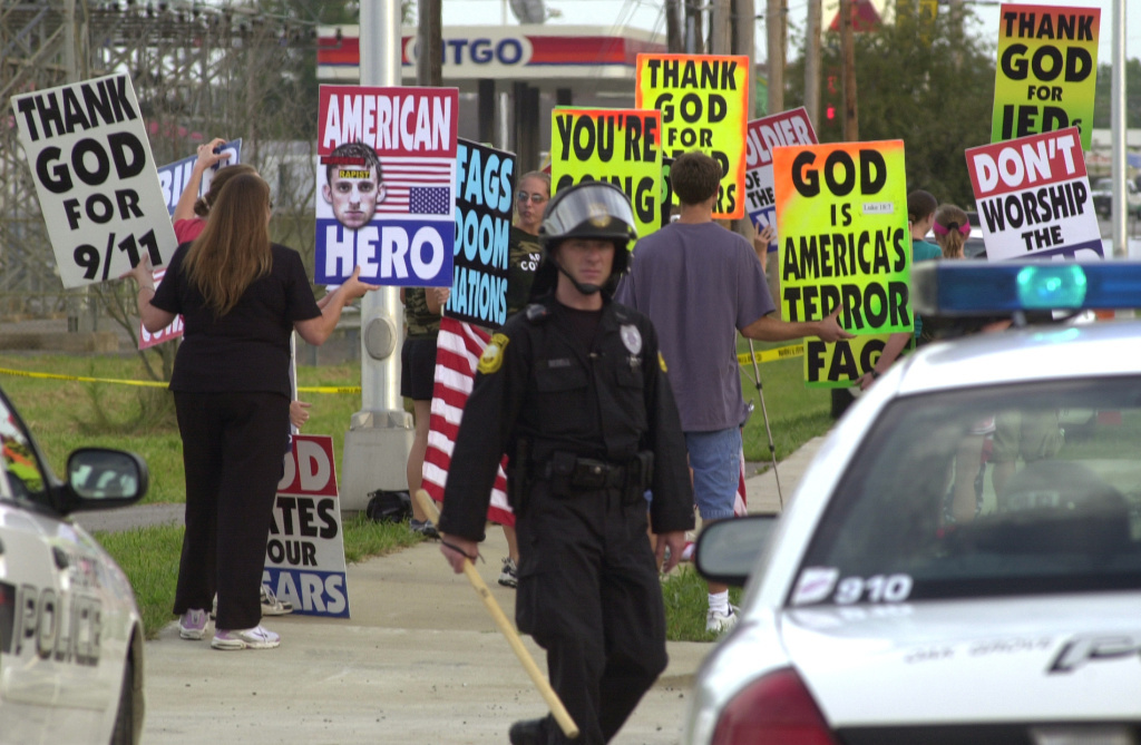 Westboro Baptist Church founder Fred Phelps is reportedly in hospice care in Topeka, Kansas. Members of the church protest outside the gates at Fort Campbell, Ky., in this 2006 photo.