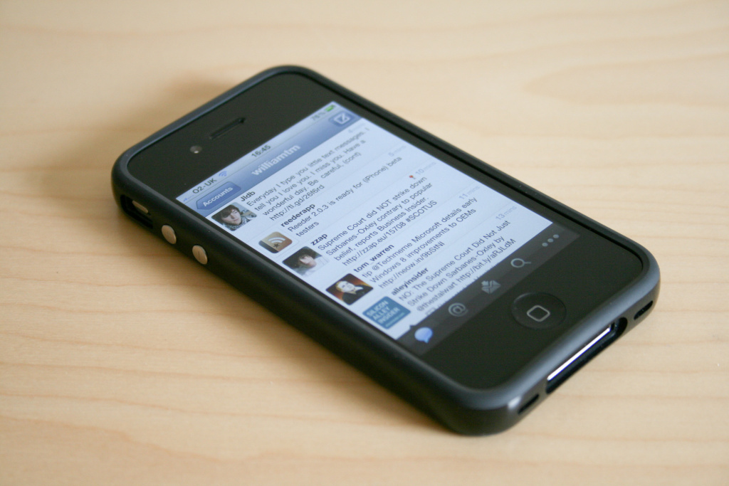 The iPhone 4 showing Twitter for iPhone.
