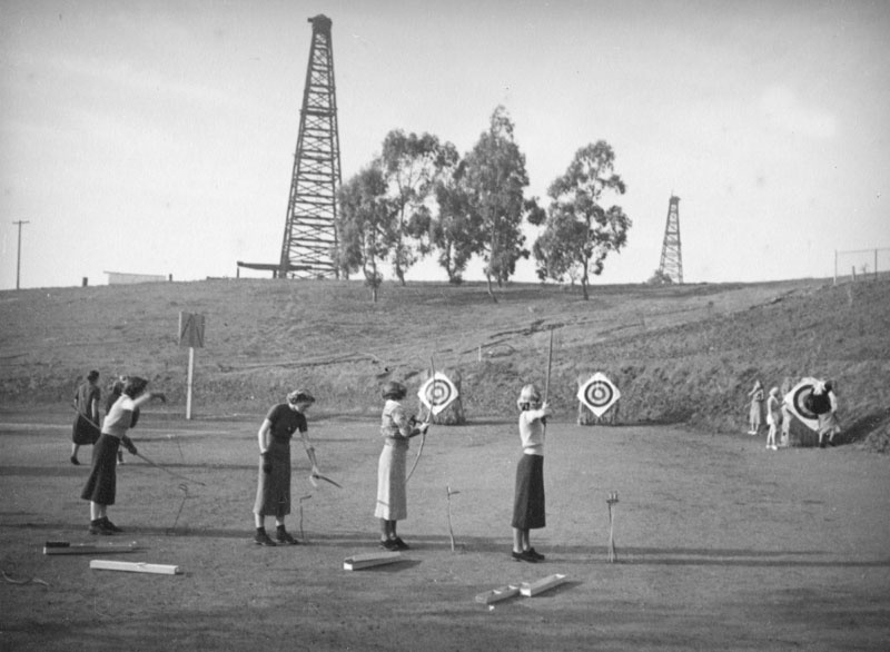 Oil wells provide the background for archery class at Beverly Hills High School in 1937. Eric Garcetti's family granted drilling rights to a property it owns about a half-mile away.