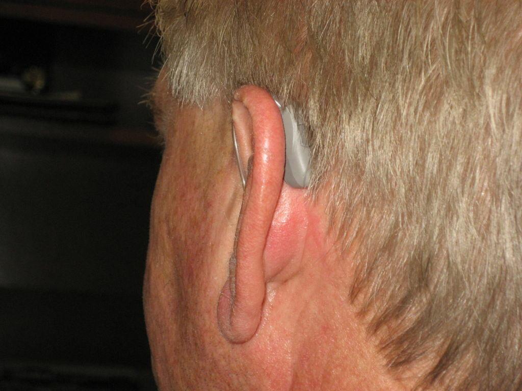 House Ear Clinic audiologist Allen Senne demonstrates one style of hearing aid.