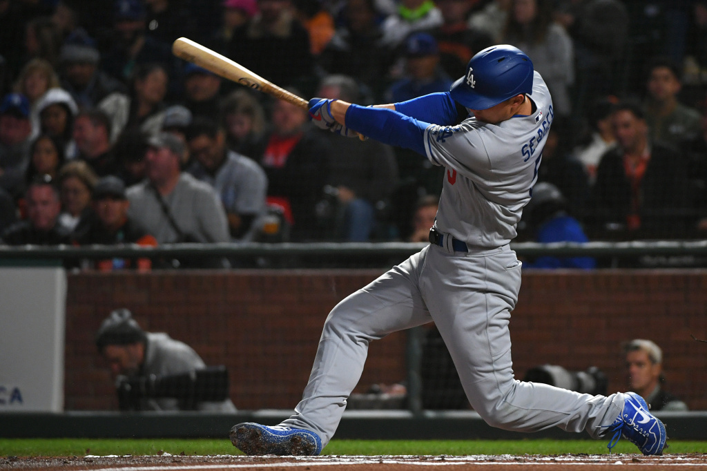 Corey Seager #5 of the Los Angeles Dodgers hits his solo home run in the second inning against the San Francisco Giants during their MLB game at Oracle Park on September 27, 2019 in San Francisco, California.
