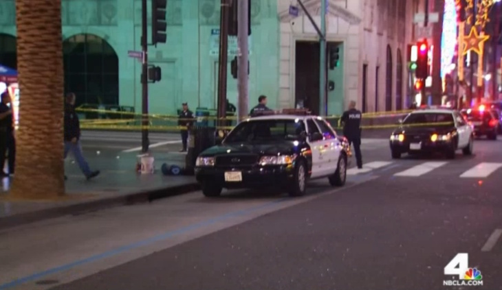 An eyewitness photo of a man who was shot at the Hollywood and Highland intersection by police on Friday, Dec. 5, 2014. (The man has been pixelated due to the graphic nature of the photo. This photo has also been cropped.