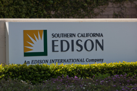 A Southern California Edison sign outside the San Onofre Nuclear Plant. The company is planning layoffs and outsourcing.