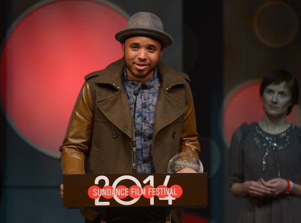 Director Justin Simien accepting the U.S. Dramatic Special Jury Award for Breakthrough Talent award at Sundance 2014 for
