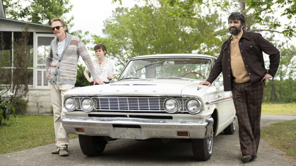 L to R: Frank (Paul Bettany) Beth (Sophia Lillis) and Walid (Peter Macdissi) pull up to the bumper in <em>Uncle Frank</em>.