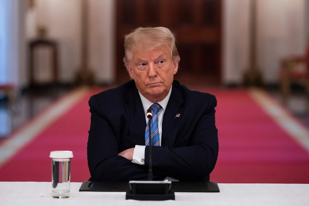 President Trump participates in a White House event Tuesday on how to reopen schools safely. After insisting that the Republican National Convention should be in person with thousands of people, Trump said he is
