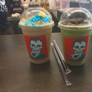 Two of the specialty drinks at Rad Coffee. Left: The Cinnamon Toast Crunch Cereal Chiller. Right: The Frankenstein, made of matcha green tea.