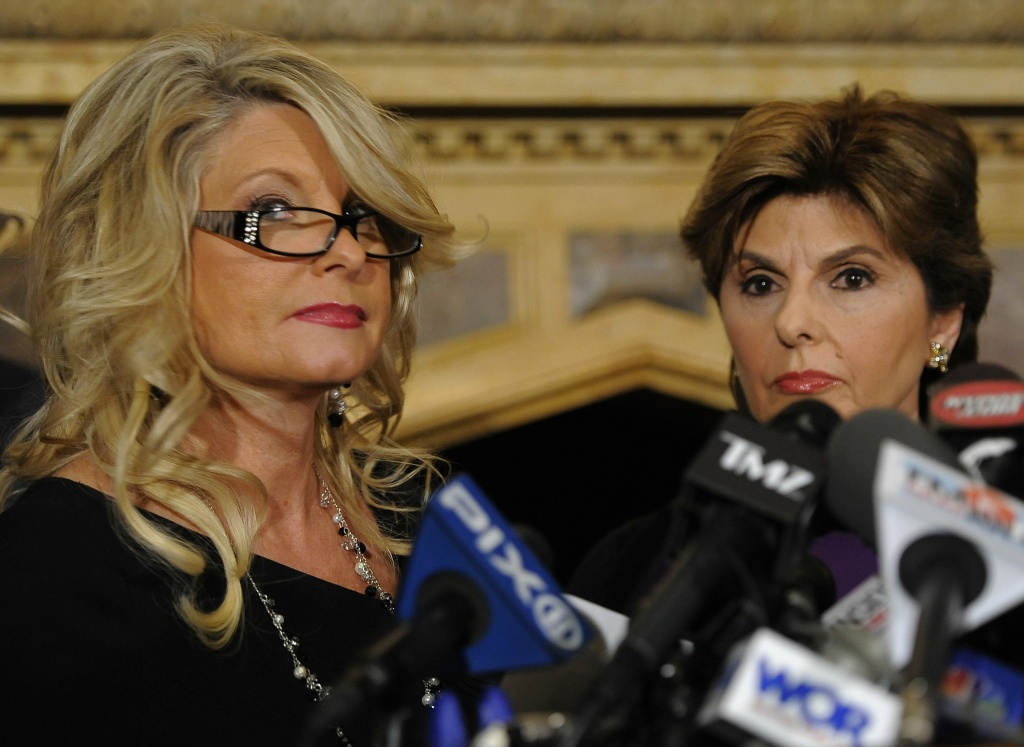 Lawyer Gloria Allred (R) speaks with Sharon Bialek (L) during a news conference in New York City on Nov. 7, 2011. Bialek was the first of four women to go public with detailed allegations.