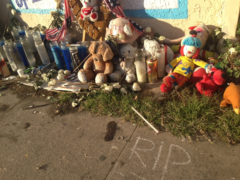 File: Candles, stuffed toys, cigarettes and beer cans are part of a memorial display for Ezell Ford.