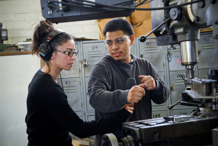 David Castro is a student at Hawthorne High School of Manufacturing and Engineering. Castro is talking to KPCC's Shereen Marisol Meraji about the metal tubes he's cutting for a robot the student's designed.