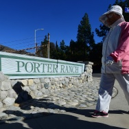 A woman takes her morning walk near the SoCal Gas Aliso Canyon storage facility in Porter Ranch, California.