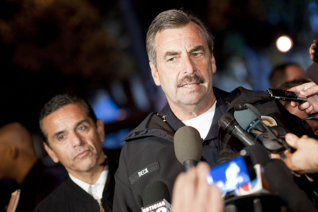 Los Angeles Police Department Chief Charlie Beck talks to members of the media in front of City Hall in downtown in the early hours of November 30, 2011 in Los Angeles, California.