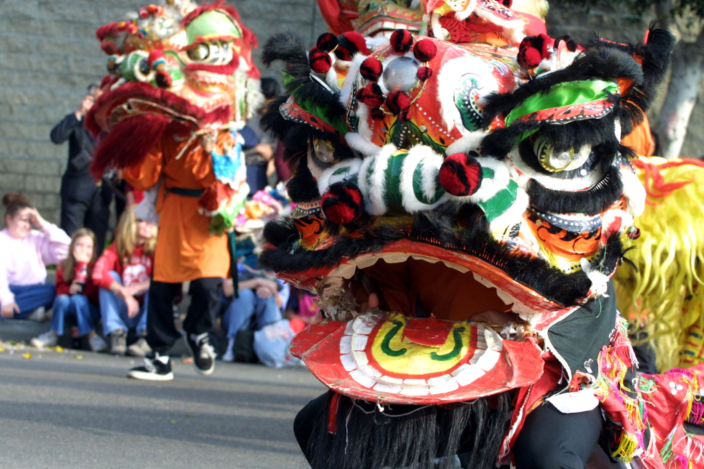 People participate in the Golden Dragon Parade in Chinatown in Los Angeles during the annual celebration of the Lunar New Year.