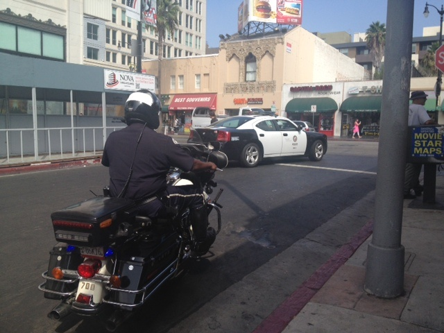 LAPD West Traffic Division motor officers conduct a pedestrian safety decoy in Hollywood to catch drivers violating traffic pedestrian laws.