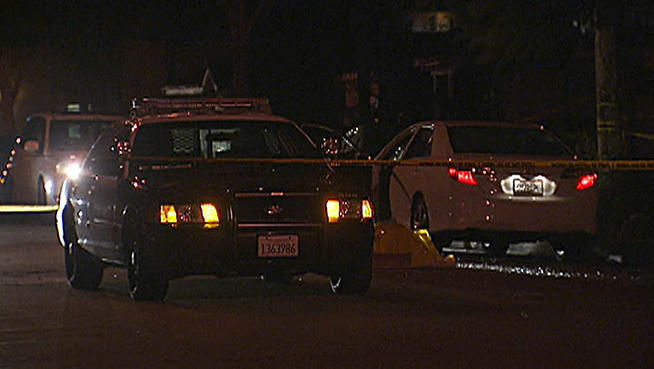 Santa Ana police block off a street to investigate an officer involved shooting early Friday morning.