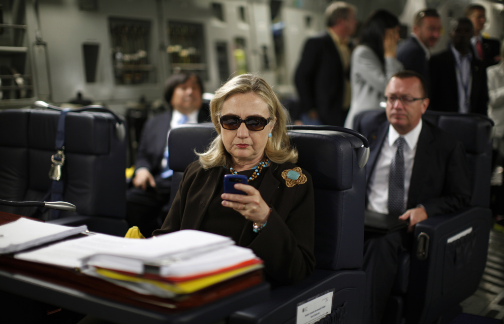 In this file photo, then-Secretary of State Hillary Rodham Clinton checks her Blackberry from a desk inside a C-17 military plane upon her departure from Malta, in the Mediterranean Sea, bound for Tripoli, Libya. Clinton used a personal email account during her time as secretary of state, rather than a government-issued email address, potentially hampering efforts to archive official government documents required by law. Clinton's office said nothing was illegal or improper about her use of the non-government account and that she believed her business emails to State Department and other .gov accounts would be archived in accordance with government rules.