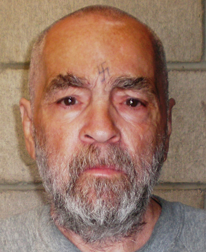 In this handout photo from the California Department of Corrections and Rehabilitation, Charles Manson, 74, poses for a photo on March 18, 2009 at Corcoran State Prison, California. Manson is serving a life sentence for conspiring to murder seven people during the