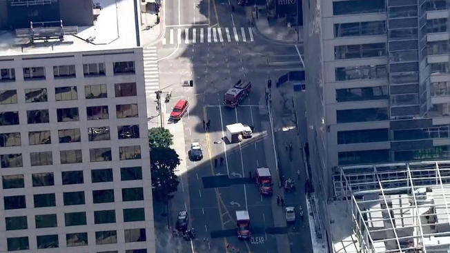 Los Angeles police have cordoned of an area near the Wilshire Grand construction site downtown as they investigate the falling death of a worker on the project.