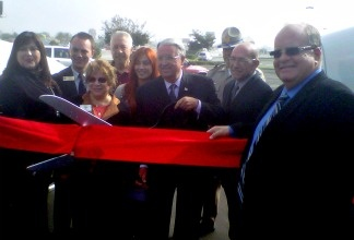 L.A. County Supervisor Don Knabe, with scissors, joins Caltrans officials for the ribbon cutting ceremony marking the opening of the westbound Pomona (60) Freeway HOV lane.
